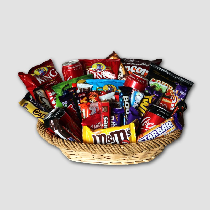Party basket with crisps, chocolate bars and coke.